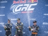(L-R) Patrick Sandell, Tanner Foust, and Brian Deegan celebrate on the podium at Round 1 of Red Bull Global Rallycross at Wild Horse Pass Motorsports Park in Phoenix, Arizona, USA on March 21, 2016